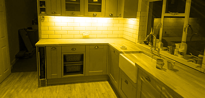 Kitchen installation with yellow fade